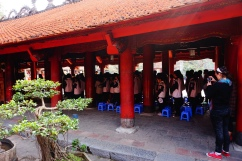 Students praying for blessings before exams at the Temple of Literature