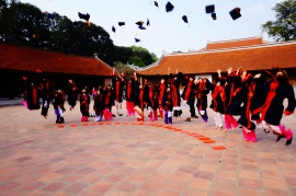 Graduating students posing for a photograph at the Temple of Literature