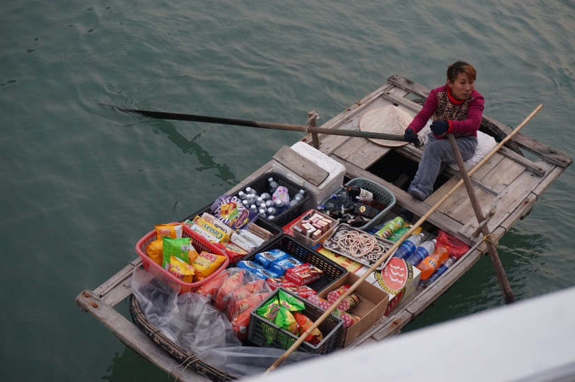 A vendor on Ha Long Bay approaching our boat