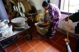Hue rice museum - this woman demonstrated the different processes Vietnamese people used to make brown rice, white rice, rice paper, and rice milk.